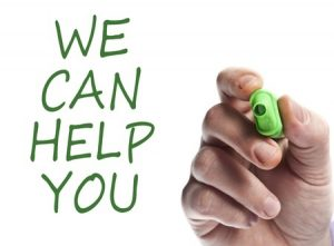 Hand with green marker writing we can help you